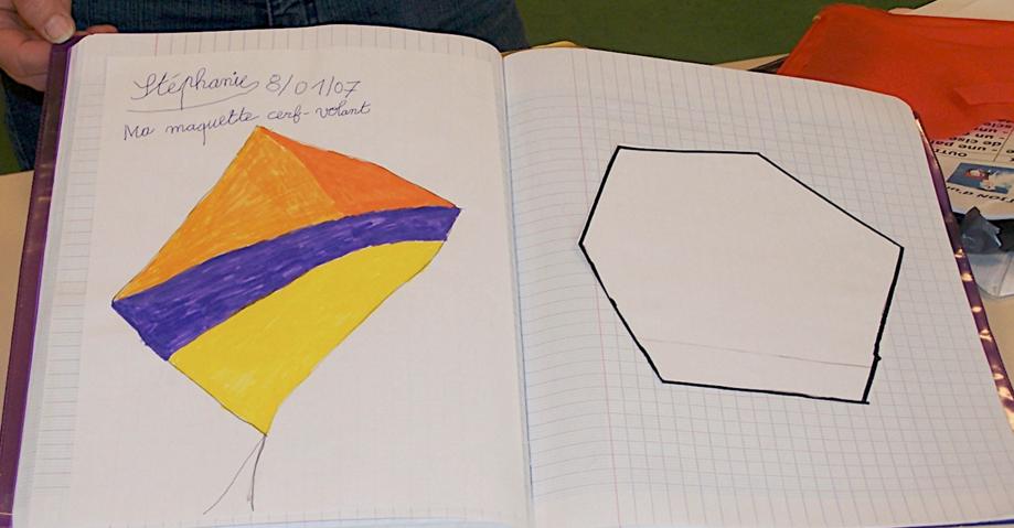 cahier d'élève avec dessins de cerf-volants
